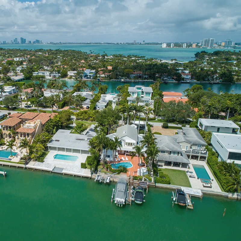Aerial view of luxury waterfront homes in Miami.