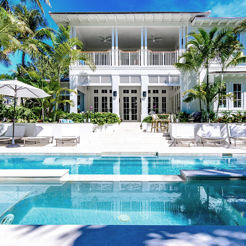 Key West style home with a view from the pool deck.