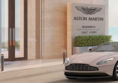 3D rendering sample of an Aston Martin car arriving at Aston Martin Residences entrance.